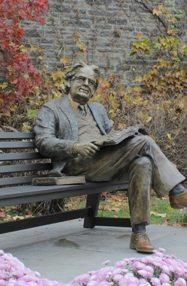 Statue of Professor Northrop Frye on the grounds of Victoria College, University of Toronto  where he used to teach invites passersby to sit and have a chat with him.