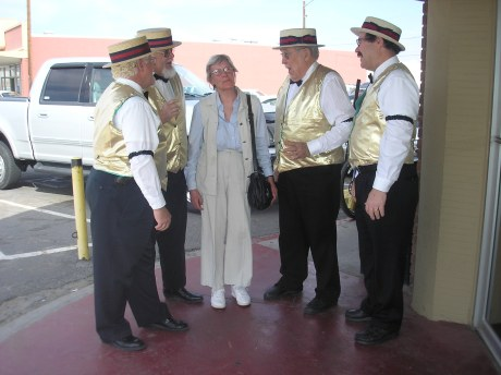 Harmonizing and singing along with a barber shop quartet in Yuma.