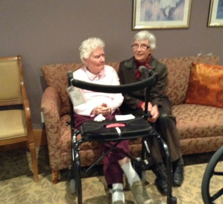 An Alzheimer patient gets a visit from her sister.